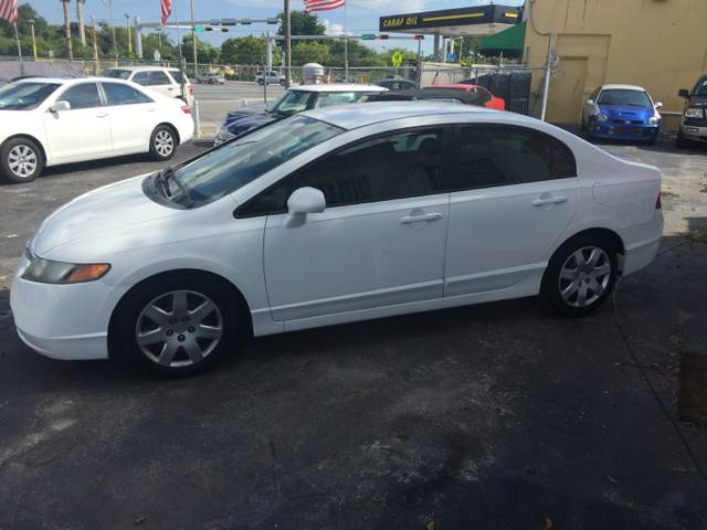2007 HONDA CIVIC LX 4DR SEDAN 18L I4 5A white this vehicle is priced 999 below the market ave