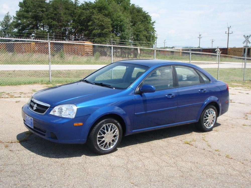 2008 SUZUKI FORENZA 4DR CAR blue 20 liter 4 cylinder15 inch wheelspower windowsmirrors and lo