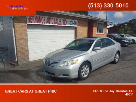 2009 Toyota Camry for sale at HERMANOS AUTO SALES INC in Hamilton OH