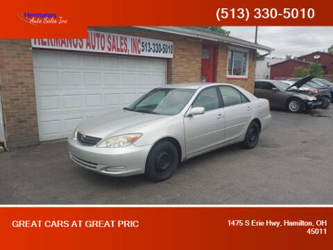 2004 Toyota Camry for sale at HERMANOS AUTO SALES INC in Hamilton OH