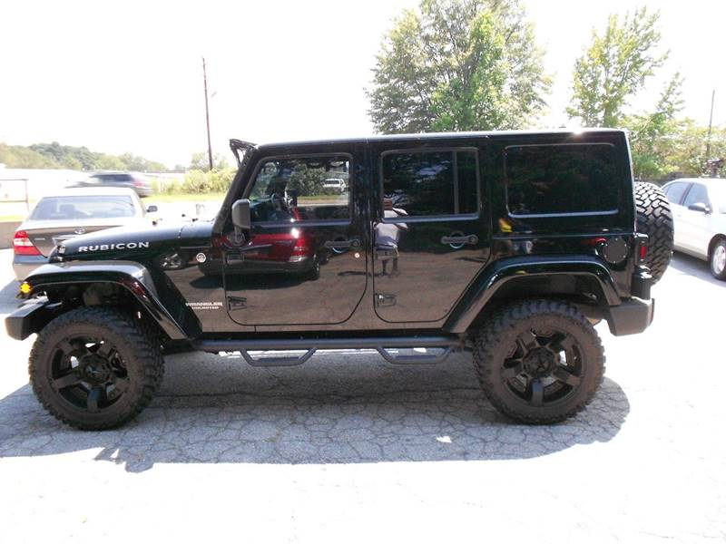 2012 Jeep Wrangler Unlimited for sale at FABULOUS AUTO SALES in Conyers GA