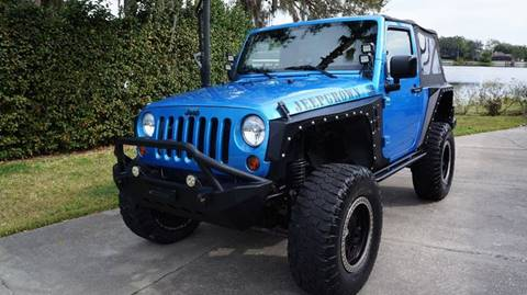 2010 Jeep Wrangler for sale at CARPORT SALES AND  LEASING in Oviedo FL