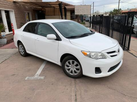 2013 Toyota Corolla for sale at CONTRACT AUTOMOTIVE in Las Vegas NV