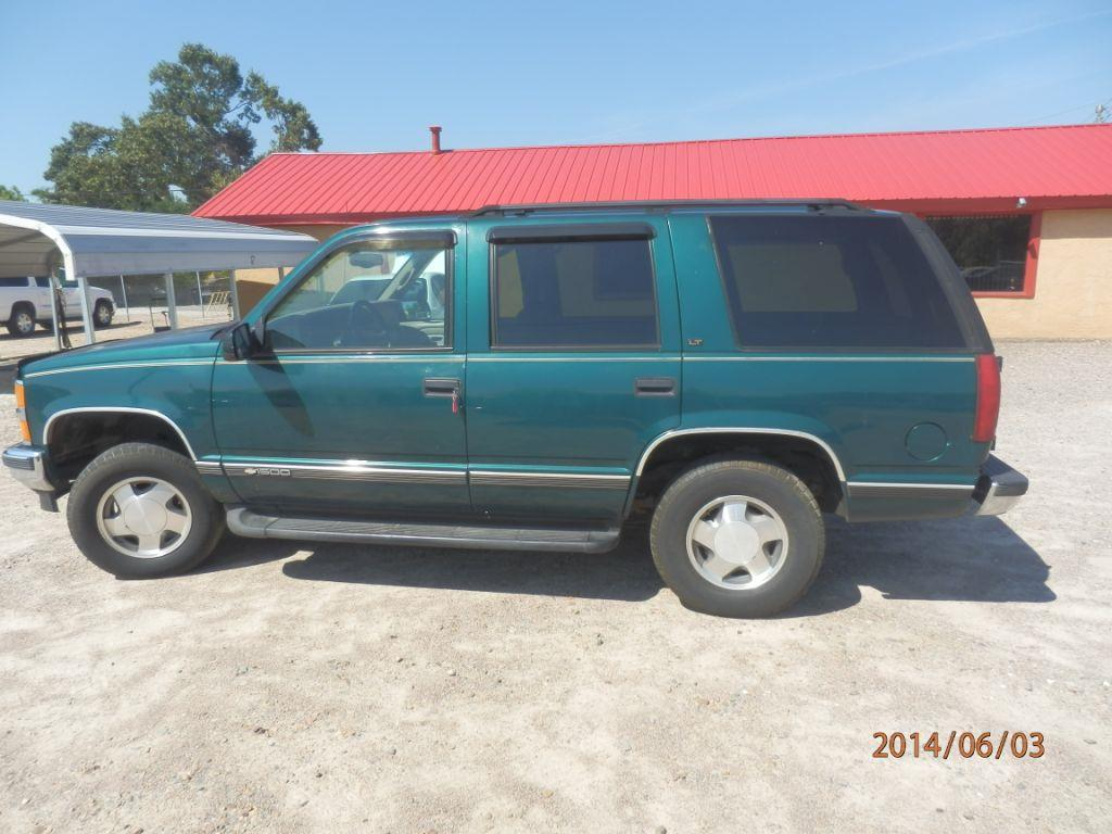 1997 CHEVROLET TAHOE greenlt down payment 150000  monthly payment 20000 for 26 months cash