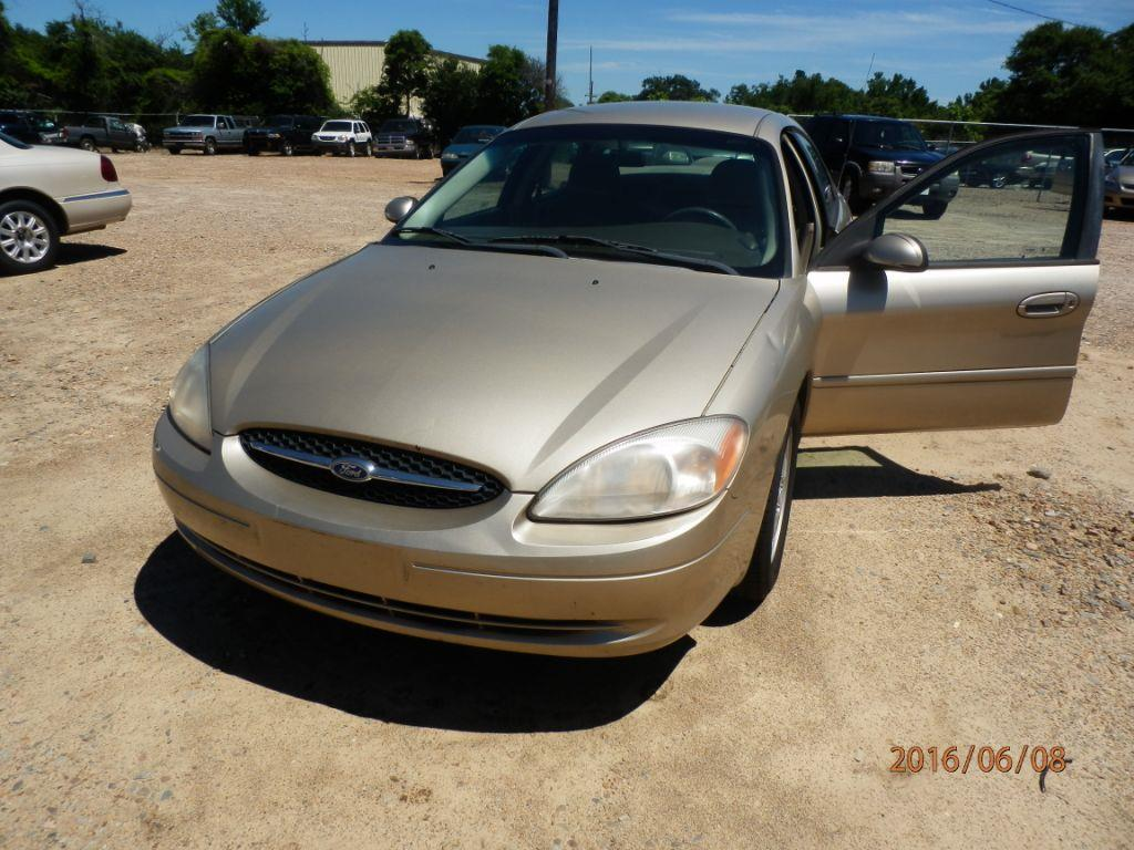 2000 FORD TAURUS SES 4DR SEDAN gold down payment 80000  monthly payment 20000 front air condi