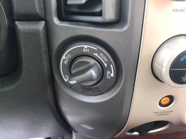 2004 Infiniti QX56 for sale at Edge Auto Sale Inc. in Sanford NC