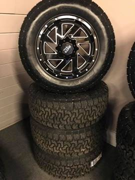 Moto Metal 8Lug Chevy Dodge MO988 W/AMP A/T Pro Tires for sale at Pop's Automotive in Homer NY