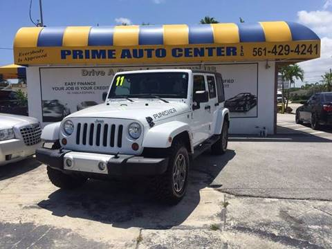 2011 Jeep Wrangler Unlimited for sale at PRIME AUTO CENTER in Palm Springs FL