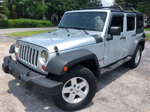 2011 Jeep Wrangler Unlimited for sale at LUXURY AUTO MALL in Tampa FL