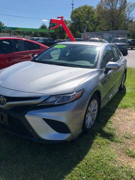 2019 Toyota Camry for sale at BRYANT AUTO SALES in Bryant AR