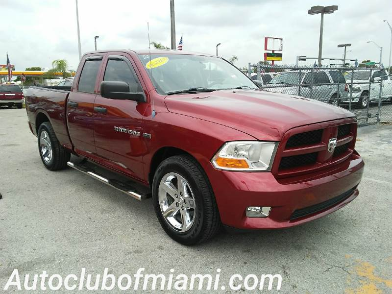 2012 RAM RAM PICKUP 1500 EXPRESS 4X2 4DR QUAD CAB 63 FT maroon all of our vehicles are clean tit