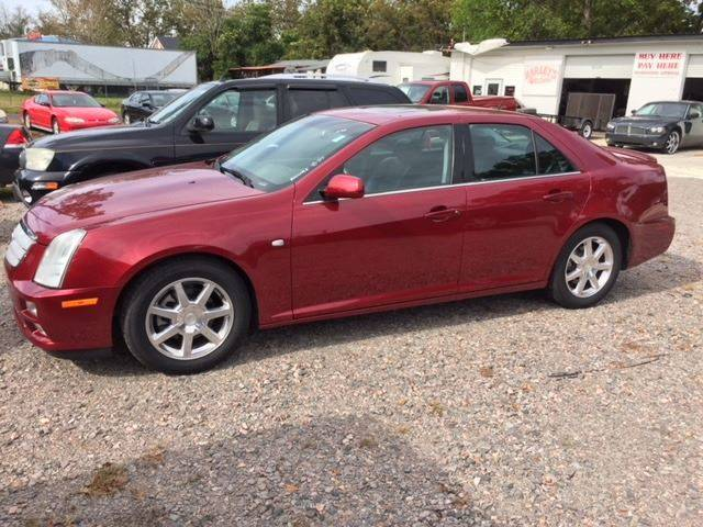 2006 CADILLAC STS V8 4DR SEDAN burgundy super nice sts v leather sunroof loaded very fast   we fi