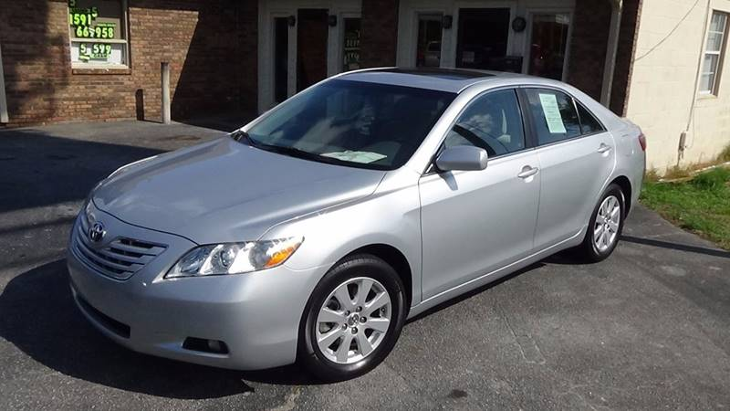 2007 Toyota Camry for sale at Britton Automotive Group in Loganville GA