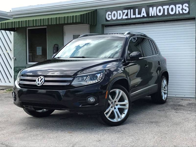 2012 VOLKSWAGEN TIGUAN SEL 4DR SUV W PREMIUM NAVIGATIO black body side moldings - chrome door ha