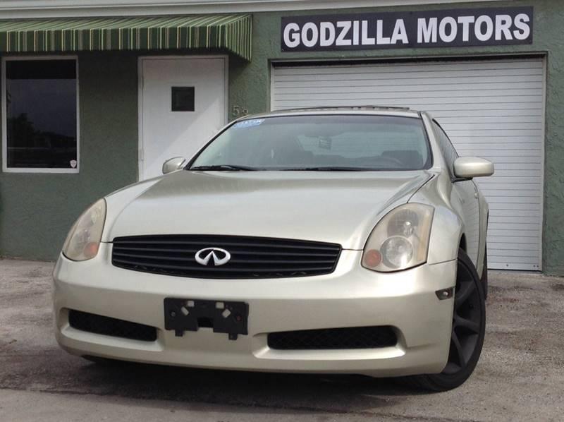 2005 INFINITI G35 BASE tan center console trim - leather dash trim - alloy door trim - alloy f