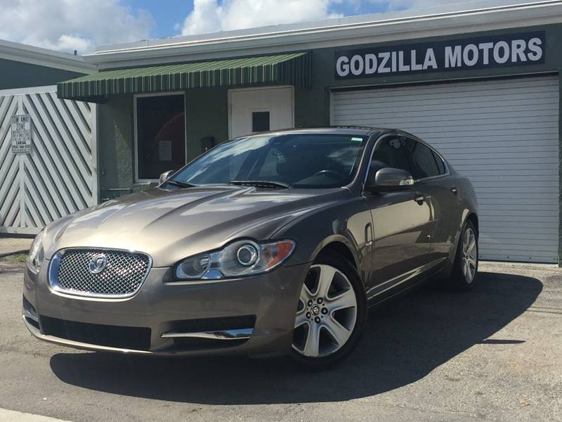 2009 JAGUAR XF LUXURY 4DR SEDAN tan grille color - chrome air filtration armrests - rear center