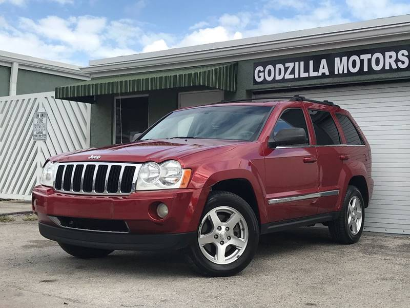 2006 JEEP GRAND CHEROKEE LIMITED 4DR SUV W FRONT SIDE AI red this one is ready to drive home and