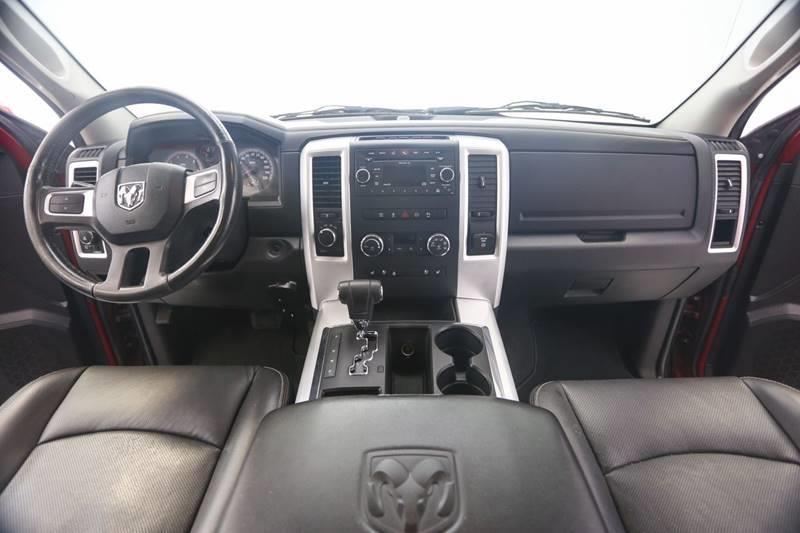 2010 Dodge Ram Pickup 1500 4x4 Laramie 4dr Quad Cab 6.3 ft. SB Pickup - Grand Rapids MI