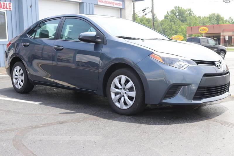 2014 Toyota Corolla for sale at State Auto Group in Cuyahoga Falls OH