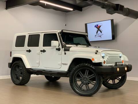 2011 Jeep Wrangler Unlimited for sale at TX Auto Group in Houston TX