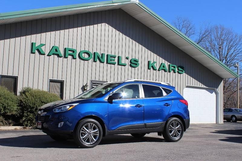 2014 Hyundai Tucson for sale at Karonels Kars in Paris TN