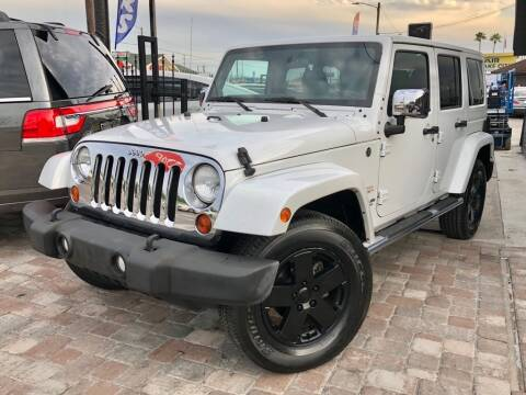 2011 Jeep Wrangler Unlimited for sale at Unique Motors of Tampa in Tampa FL