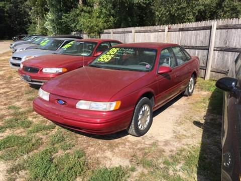 1995 Ford Taurus for sale at Northwoods Auto & Truck Sales in Machesney Park IL
