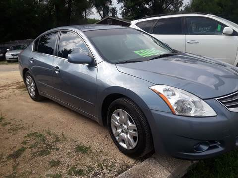 2012 Nissan Altima for sale at Northwoods Auto & Truck Sales in Machesney Park IL
