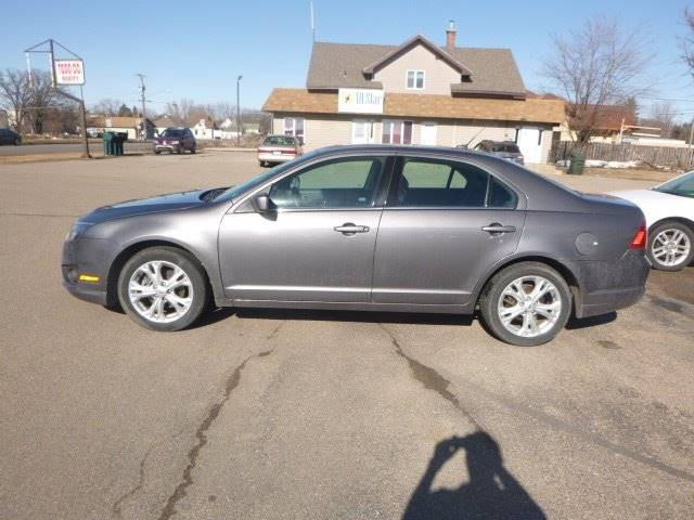 2012 Ford Fusion for sale at JIM WOESTE AUTO SALES & SVC in Long Prairie MN