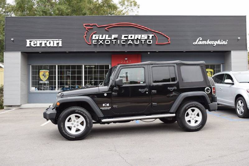 2009 Jeep Wrangler Unlimited for sale at Gulf Coast Exotic Auto in Biloxi MS