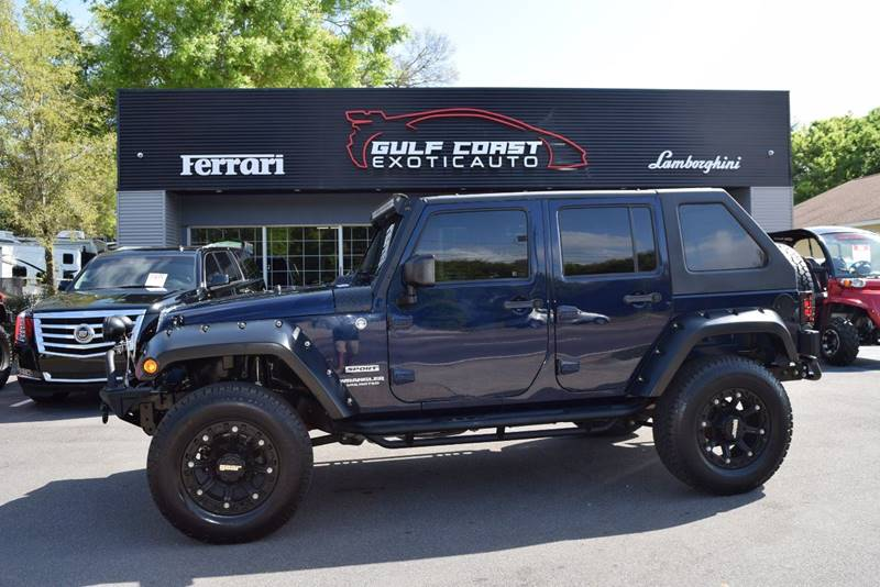 2013 Jeep Wrangler Unlimited for sale at Gulf Coast Exotic Auto in Biloxi MS