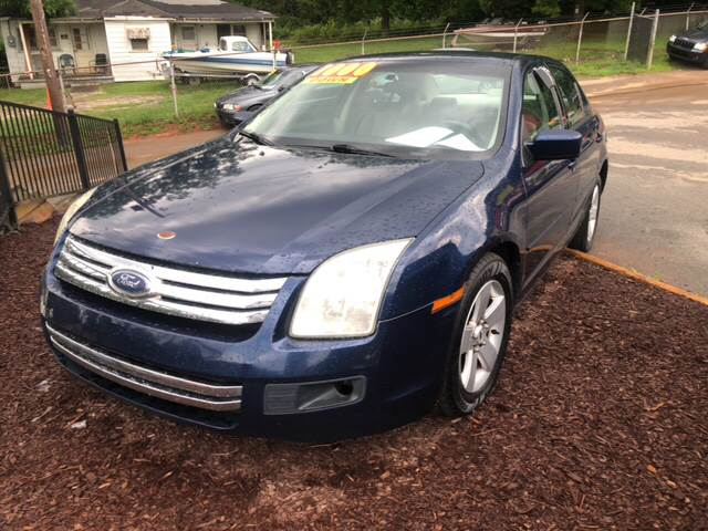 2006 Ford Fusion I4 SE In Buford GA - KAR KINGDOM  Ford Fusion on 2001 ford fusion, 2007 ford fusion, toyota camry, ford flex, brakes for ford fusion, honda accord, ford taurus, 2004 ford fusion, 2030 ford fusion, 2015 ford fusion, chevrolet malibu, 1997 ford fusion, 2003 ford fusion, 2008 ford fusion, 2005 ford fusion, 2002 ford fusion, ford fusion hybrid, nissan altima, ford fiesta, ford expedition, 2000 ford fusion, ford focus, hyundai sonata, ford mustang, ford explorer, 2006 white fusion, 2020 ford fusion, custom ford fusion, chevrolet impala, lincoln mkz, 1993 ford fusion, ford motor company, ford escape, 2014 ford fusion, 1986 ford fusion, 200 ford fusion, ford mondeo, ford edge,
