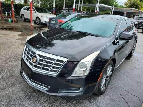 2013 Cadillac XTS for sale at America Auto Wholesale Inc in Miami FL