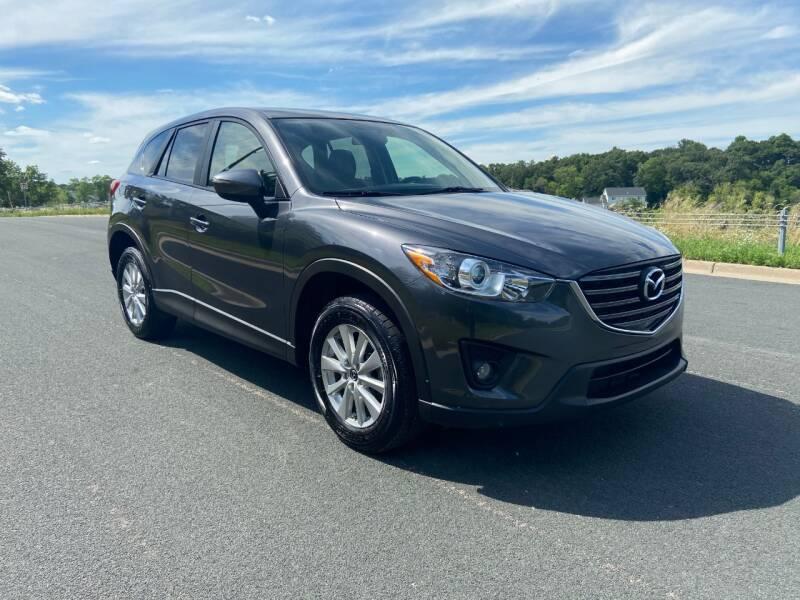 2015 Mazda CX-5 for sale at Universal Motors in Prior Lake MN