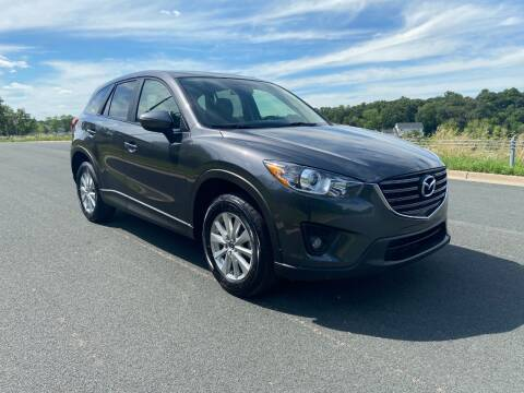 2015 Mazda CX-5 for sale at Universal Motors in Prior Lake MN