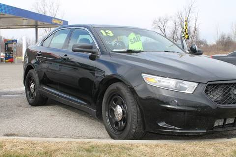 2013 Ford Taurus for sale at Markham Motors in Perry MI
