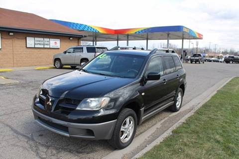 2003 Mitsubishi Outlander for sale at Markham Motors in Perry MI