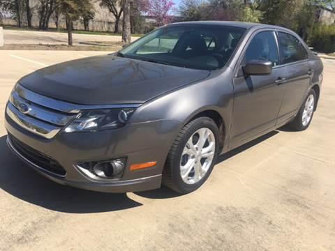 2012 Ford Fusion for sale at Safe Trip Auto Sales in Dallas TX