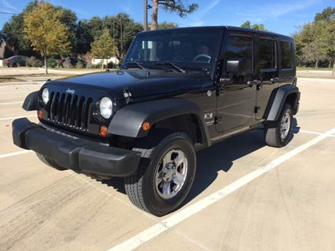 2009 Jeep Wrangler Unlimited for sale at Safe Trip Auto Sales in Dallas TX