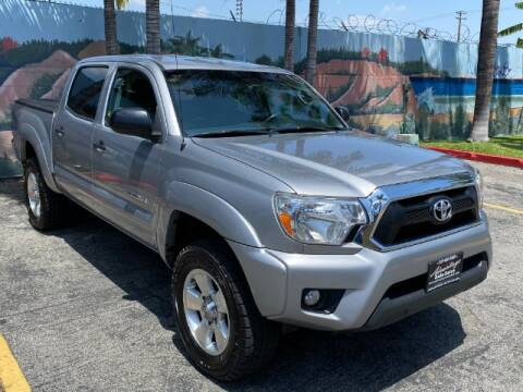 2014 Toyota Tacoma for sale at ADVANTAGE AUTO SALES INC in Bell CA