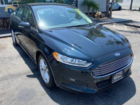 2014 Ford Fusion for sale at ADVANTAGE AUTO SALES INC in Bell CA