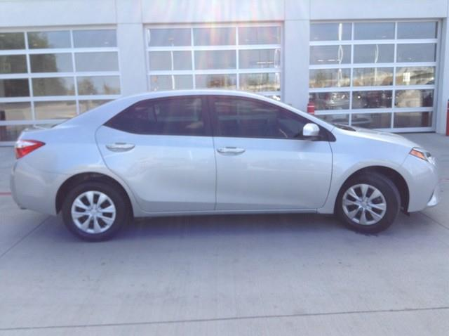 2015 Toyota Corolla for sale at Cowboy Toyota in Dallas TX