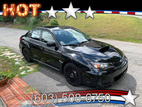 2011 Subaru Impreza for sale at J & E AUTOMALL in Pelham NH