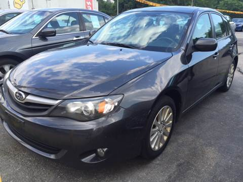 2011 Subaru Impreza for sale at DISTINCTIVE MOTOR CARS UNLIMITED in Johnston RI