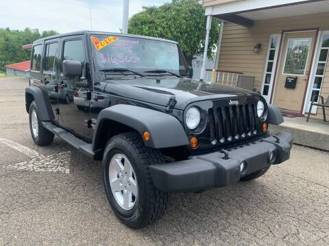 2012 Jeep Wrangler Unlimited Sport for sale at G & G Auto Sales in Steubenville OH