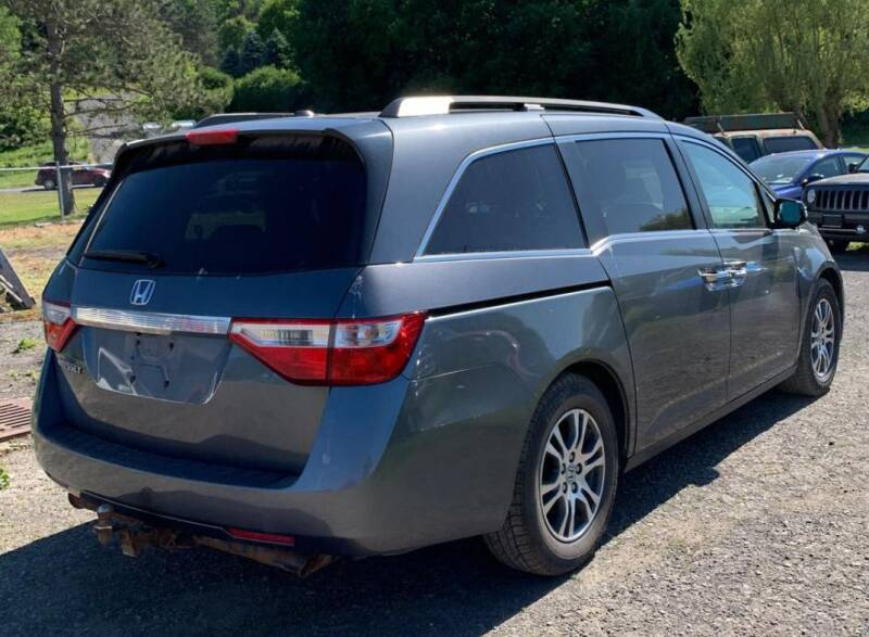 2011 Honda Odyssey for sale at The Bengal Auto Sales LLC in Hamtramck MI