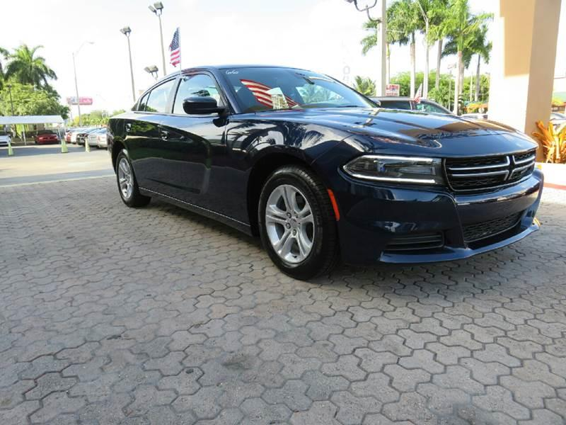 2015 DODGE CHARGER SE 4DR SEDAN blue the showroom miami is a family owned first class used car d