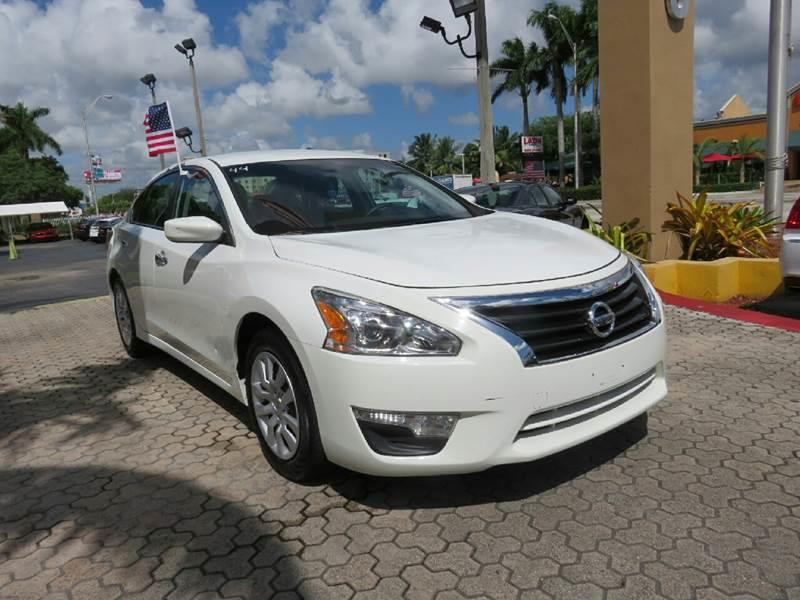 2015 NISSAN ALTIMA 25 S 4DR SEDAN white the showroom miami is a family owned first class used c