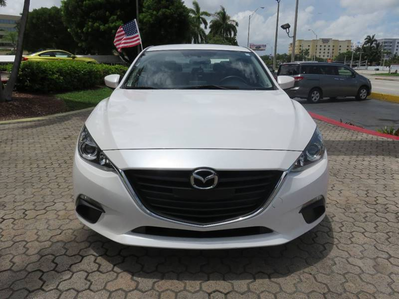 2016 MAZDA MAZDA3 I SPORT 4DR SEDAN 6A white exhaust - dual tip door handle color - body-color