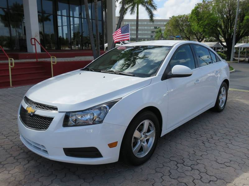 2014 CHEVROLET CRUZE 1LT AUTO 4DR SEDAN W1SD white the showroom miami is a family owned first c
